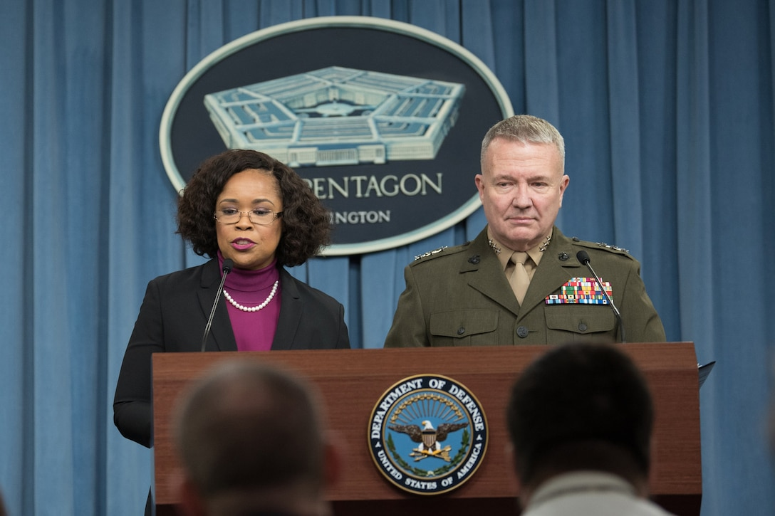The chief Pentagon spokesperson and a Marine Corps general speak at a podium.