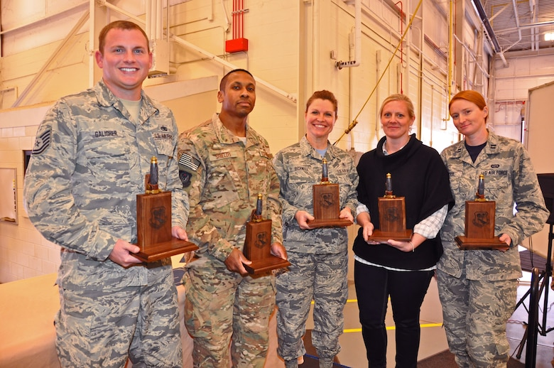 The 919th Special Operations Wing's annual award winners for the period October 2016 to September 2017 display their trophies during a ceremony