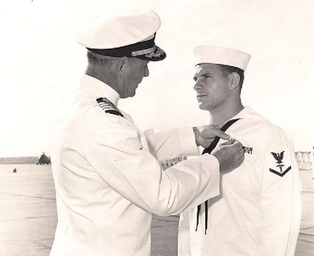 """Navy Hospital Corpsman 3rd Class Michael Kuklenski receives a Silver Star in April 1970 at the Albany, Ga., Naval Air Station, for his actions during a May 29, 1969, firefight in Quang Nam province while serving with Alpha Co., 1st Bn., 7th Marines. Kuklenski, who was wounded three times in the engagement, """"fearlessly crawled across the fire-swept terrain to reach wounded Marines and administer first aid."""" He """"continued to provide medical care to the other casualties"""" before accepting treatment for himself, according to his Silver Star citation. (Photo by Michael Kuklenski)"""