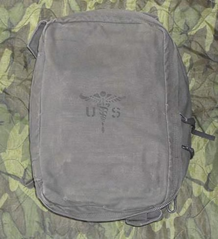 This rectangular canvas rucksack contains large internal space for storing various assorted medical equipment. It has several inner pockets and ties to keep an M5 aid bag secure. The M5 bag contained all the medical supplies a platoon would need. (Photo courtesy of Army Medical Department Center of History and Heritage, U.S. Army Medical Command)