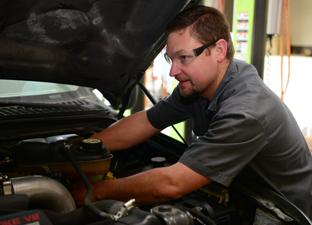 Jesse McManis, 9th Support Division heavy mobile equipment mechanic, replaces a master cylinder