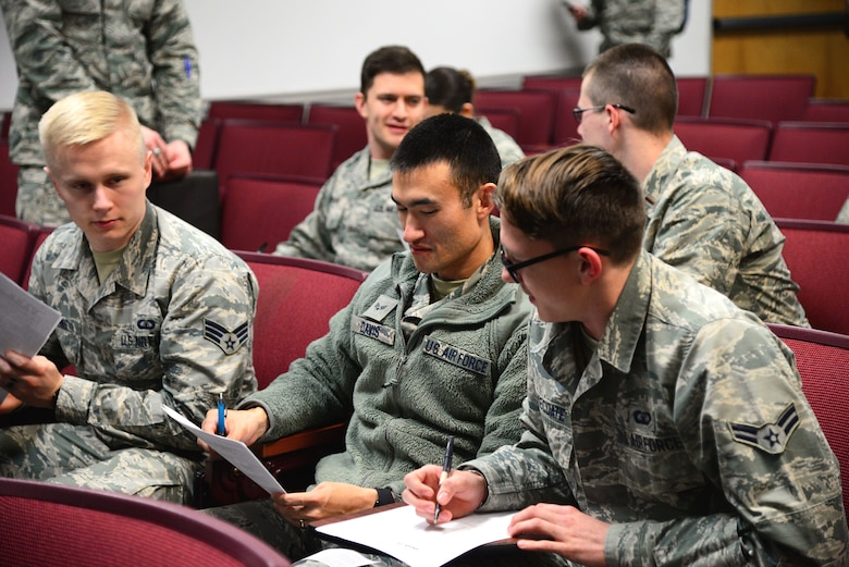 Participants of an Adaptive Flight Training Study complete a pre-study questionnaire Jan. 9, 2018, on Columbus Air Force Base, Mississippi. Over 30 participants were involved in the study, with 15 of those subjects wearing heart monitors to gather additional data. Researchers were at Columbus AFB for three days, with each participant flying for up to an hour, two days in a row. (U.S. Air Force photo by Airman 1st Class Keith Holcomb)