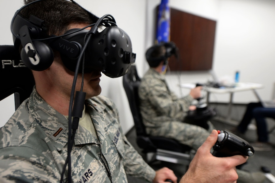 Second Lt. Kenneth Soyars, 14th Student Squadron student pilot, takes off during a virtual reality flight simulation Jan. 10, 2018, on Columbus Air Force Base, Mississippi. Two subjects flew at a time but no other subjects were allowed to watch or learn from other individuals' sorties. The Adaptive Flight Training Study pushed subjects to learn through the VR technology. (U.S. Air Force photo by Airman 1st Class Keith Holcomb)