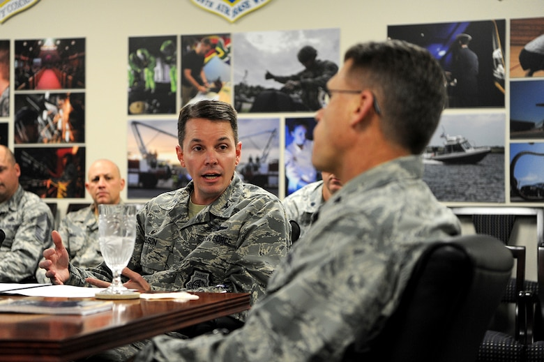 U.S. Air Force Col. Jeff W. Nelson, 628th Air Base Wing commander, provides a Joint Base Charleston mission brief to Brig. Gen. Steven J. Bleymaier, director of logistics, engineering and force protection, Headquarters Air Mobility Command, Scott Air Force Base, Ill, Jan. 9, 2018. Bleymaier visited JB Charleston to get a better understanding of joint operational capabilities and to meet with services members.