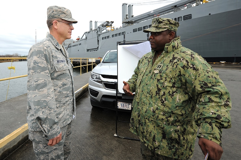 Navy Lt. Brandley Sinoc, right, Port Operations officer, briefs U.S. Air Force Brig. Gen. Steven J. Bleymaier, director of logistics, engineering and force protection, Headquarters Air Mobility Command, Scott Air Force Base, Ill on how seaport infrastructure impacts operations and other tenant commands on Joint Base Charleston - Weapons Station, Jan. 10, 2018. Bleymaier visited JB Charleston to get a better understanding of joint operational capabilities and to meet with services members.