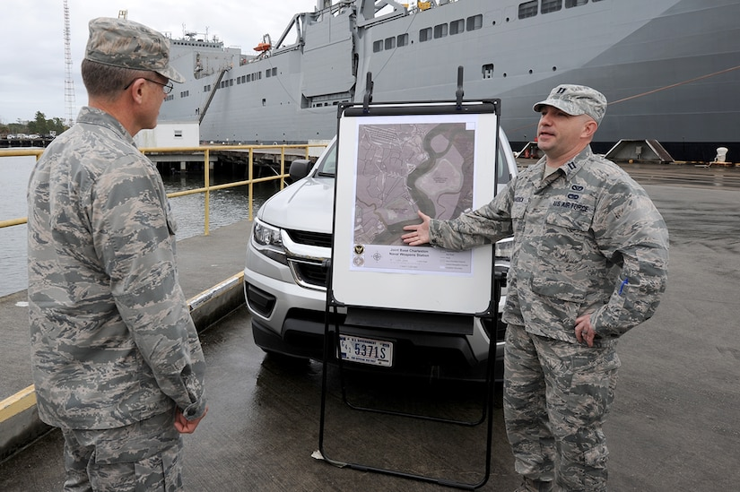 U.S. Air Force Capt. Steven Braddick, right, 628th Civil Engineer Squadron Weapons Station element chief briefs U.S. Air Force Brig. Gen. Steven J. Bleymaier, director of logistics, engineering and force protection, Headquarters Air Mobility Command, Scott Air Force Base, Ill about the importance of dredging every 18 months so prepositioned ships can enter Wharf Alpha at Joint Base Charleston – Weapons Station, Jan. 10, 2018. General Bleymaier visited JB Charleston to get a better understanding of joint operational capabilities and to meet with services members.