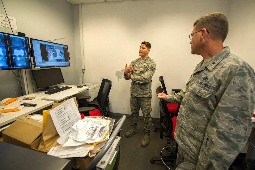 U.S. Air Force Senior Airman Angel Contreras, left, 437th Aircraft Maintenance Squadron consolidated tool kit custodian, briefs U.S. Air Force Brig. Gen. Steven J. Bleymaier, director of logistics, engineering and force protection, Headquarters Air Mobility Command, Scott Air Force Base, Ill at Joint Base Charleston, Jan. 10, 2018. Contreras highlighted the continuous process improvement tool inspection room which reduced wait time by 88 percent. This allows maintainers more time to keep Joint Base Charleston C-17s mission ready. General Bleymaier visited JB Charleston to get a better understanding of joint operational capabilities and to meet with services members.