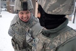 Senior Airman Tina-Louise Dunbar, a native of Anchorage, Alaska, left, and Airman 1st Class Kaylon Thomas, a native of Conway, Ark., both assigned to the 673d Security Forces Squadron, share a laugh on the gun line during a machine gun qualification range on Joint Base Elmendorf-Richardson, Alaska, Jan. 10, 2018. Security Forces Airmen perform extensive training in law enforcement as well as combat tactics to protect U.S. Military bases and assets both stateside and overseas.