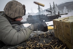 Senior Airman Tina-Louise Dunbar, a native of Anchorage, Alaska, assigned to the 673d Security Forces Squadron, fires on a target with an M249 Squad Automatic Weaponduring a machine gun qualification range on Joint Base Elmendorf-Richardson, Alaska, Jan. 10, 2018. Security Forces Airmen perform extensive training in law enforcement as well as combat tactics to protect U.S. Military bases and assets both stateside and overseas.