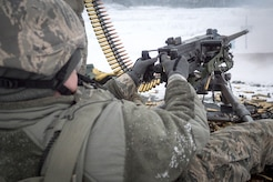 An Airman assigned to the 673d Security Forces Squadron fires an M2 .50 Caliber machine gun during a qualification range on Joint Base Elmendorf-Richardson, Alaska, Jan. 10, 2018. Security Forces Airmen perform extensive training in law enforcement as well as combat tactics to protect U.S. Military bases and assets both stateside and overseas.