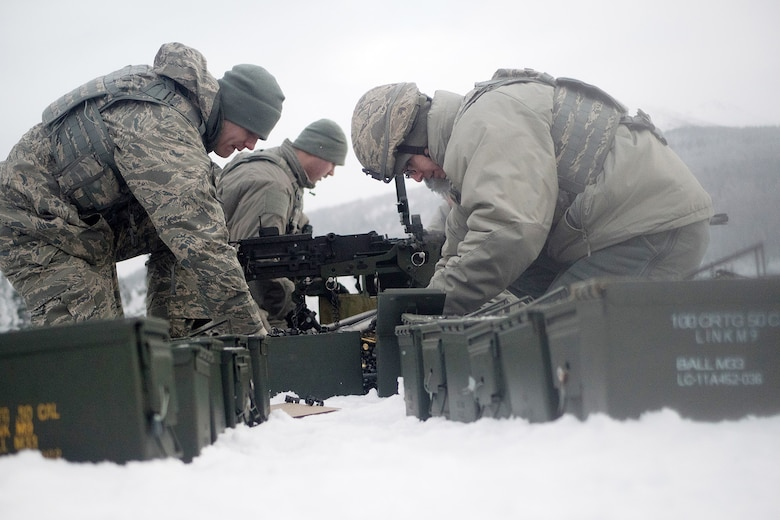 Airmen assigned to the 673d Security Forces Squadron pick up expended casings after conducting a machine gun qualification range on Joint Base Elmendorf-Richardson, Alaska, Jan. 10, 2018. Security Forces Airmen perform extensive training in law enforcement as well as combat tactics to protect U.S. Military bases and assets both stateside and overseas.
