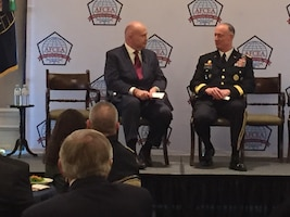 Washington television host Francis Rose, left, moderates a discussion with Army Lt. Gen. Alan R. Lynn, director of the Defense Information Systems Agency.