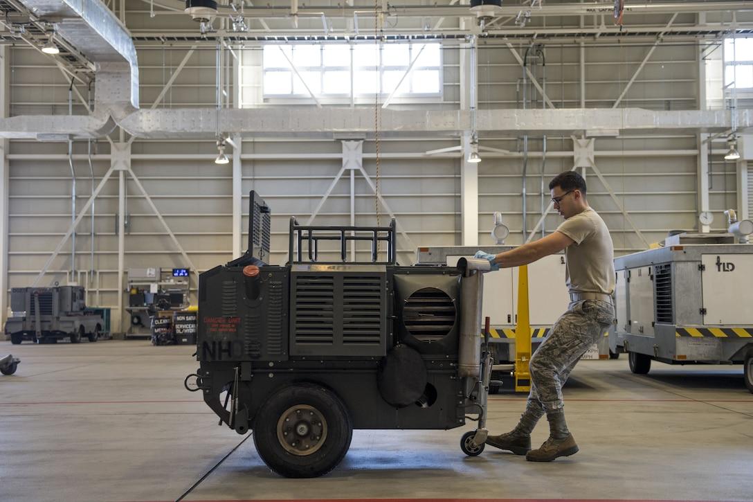 An Airmen with the 374th Maintenance Squadron aerospace ground equipment flight moves a piece of equipment, Jan. 10, 2018, at Yokota Air Base, Japan.