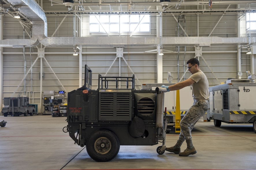 An Airmen with the 374th Maintenance Squadron aerospace ground equipment flight moves a piece of equipment, Jan. 10, 2018, at Yokota Air Base, Japan.