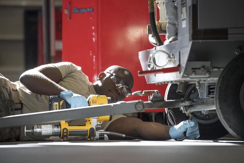 A 374th Maintenance Squadron aerospace ground equipment technician performs regular preventative maintenance on a flightline generator, Jan. 10, 2018, at Yokota Air Base, Japan.