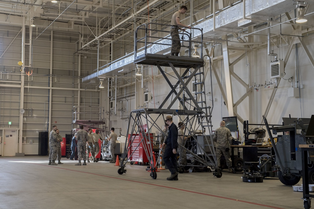 Airmen work in the 374th Maintenance Squadron aerospace ground equipment inspections section, Jan. 10, 2018, at Yokota Air Base, Japan.