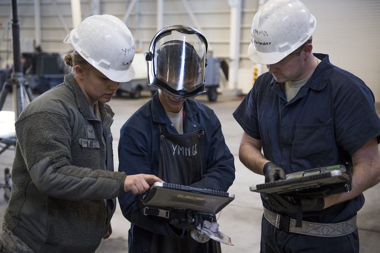 Airmen with the 374th Maintenance Squadron aerospace ground equipment flight work together to double check proper inspection regulations, Jan. 10, 2018, at Yokota Air Base, Japan.
