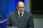 Anthony M. Kurta, deputy assistant secretary of defense for military personnel policy, speaks at the Pentagon Force Protection Agency Human Trafficking Awareness Day seminar at the Pentagon, Jan. 11, 2018. Screenshot via Defense.gov