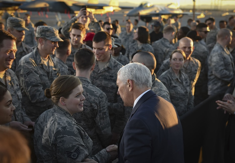 Vice President Mike Pence greets Staff Sgt. Samantha Henry, 99th Force Support Squadron dorm manager, following his address to Airmen at Nellis Air Force Base, Nevada, Jan. 11, 2018. As the sun set on the desert horizon, the vice president made his way through the crowd, shaking hands and snapping photos with the Airmen. (U.S. Air Force photo by Airman 1st Class Andrew Sarver)