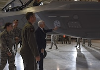 Vice President Mike Pence gets a firsthand look at the F-35 Lightning II fighter jet in the Thunderbirds Hangar at Nellis Air Force Base, Nevada, Jan. 11, 2018.  Nellis AFB provides the tools and tactical training to prepare today's Airmen to react within seconds during real world operations and meet the need for air superiority. (U.S. Air Force photo by Airman 1st Class Andrew Sarver)