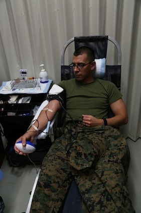 CAMP FOSTER, OKINAWA, Japan – Staff Sgt James Hernandez donates blood Jan. 11 at the Single Marine Program blood drive aboard Camp Foster, Okinawa, Japan.