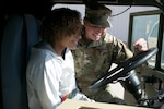 Sgt. Heather Davis shows 19-year old Adrian Hinton the ins and outs of an Oklahoma Army National Guard fuel tanker at the Armed Forces Reserve Center in Norman, January 6. Davis escorted Adrian around the AFRC as part of the