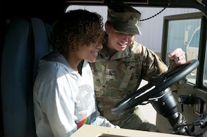 Sgt. Heather Davis shows 19-year old Adrian Hinton the ins and outs of an Oklahoma Army National Guard fuel tanker at the Armed Forces Reserve Center in Norman.