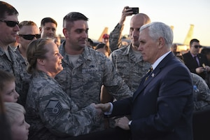 Vice President Mike Pence shakes hands with airmen.