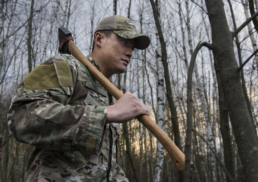 U.S. Air Force TSgt. Lee Young, 86th Operations Group Survival, Evasion, Resistance, and Escape noncommissioned officer in charge, walks through the woods on Ramstein Air Base, Germany, Jan. 11, 2018. Lee, who has trained approximately 2,000 personnel on how to stay alive in austere conditions, believes that survival is 10 percent physical and 90 percent mental. (U.S. Air Force illustration by Senior Airman Elizabeth Baker)
