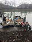 U.S. Army Staff Sgt. Shay Rich and Sgt. Nick Thongdara of the West Virginia National Guard's 35th Civil Support Team (Weapons of Mass Destruction) collect water samples from the Big Sandy River just south of Kenova in Wayne County, W.Va. Jan. 11, 2018. The 35th CST supports the State of West Virginia and civil authorities in a Chemical, Biological, Radiological, Nuclear and High Yield Explosives (CBRNE) domestic incident by identifying unknown agents or substances at a site, assessing current and project consequences, advising on response measures and assisting with the appropriate request for additional state and federal support.
