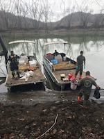 U.S. Army Staff Sgt. Shay Rich and Sgt. Nick Thongdara of the West Virginia National Guard's 35th Civil Support Team (Weapons of Mass Destruction) collect water samples from the Big Sandy River just south of Kenova in Wayne County, W.Va. Jan. 11, 2018.