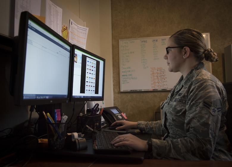 Airman 1st Class Kassandra Gonzalez, a force management technician assigned to the 6th Force Support Squadron, works on awards and decorations at MacDill Air Force Base, Fla., Jan. 10, 2018. The awards and decorations office assists military members on a variety of tasks from walk-in customers and email questions, to reviewing Case Management System cases and managing virtual personnel center for any pending evaluations and decorations. (U.S. Air Force photo by Senior Airman Mariette Adams)