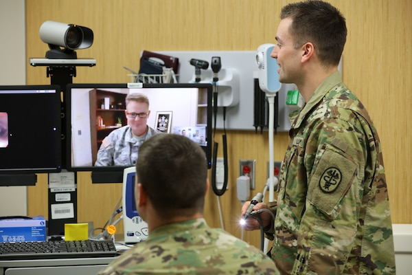 In a demonstration of the virtual health process, Lt. Col. Kevin A. Horde, a provider at Fort Gordon's Eisenhower Medical Center, offers remote consultation to mock patient Master Sgt. Jason H. Alexander with the nursing assistance of Lt. Maxx P. Mamula at Fort Campbell's Blanchfield Army Community Hospital. The Army recently opened a centralized virtual health medical center at Brooke Army Medical Center in Texas, Jan. 4, 2018.