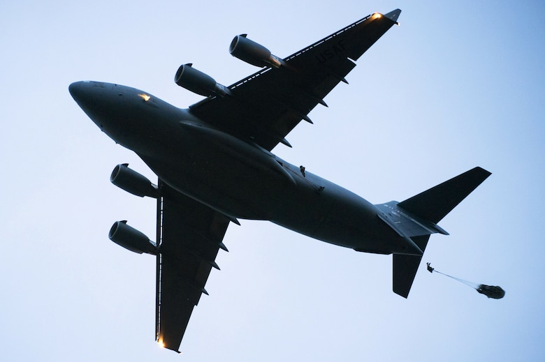 Tactical air control party specialists, assigned to the 3rd Air Support Operations Squadron, jump from a C-17 Globemaster III while conducting airborne jump training over Malemute drop zone at Joint Base Elmendorf-Richardson, Alaska, May 18, 2017. The C-17 Globemaster III was operated by Airmen assigned to the 517th Airlift Squadron. (U.S. Air Force photo by Alejandro Pena)