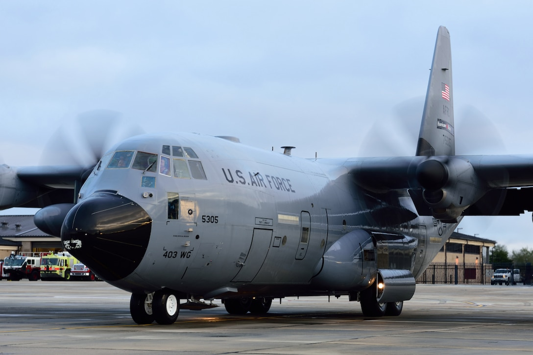 "Aircrew members from the 53rd Weather Reconnaissance Squadron ""Hurricane Hunters"" taxi a WC-130J Super Hercules aircraft to its parking spot on the runway at Keesler Air Force Base, Mississippi, after a winter storm flight Jan. 12, 2018. In addition to their hurricane taskings, Hurricane Hunters fly winter storm missions to gather weather data used by forecasters in generating models for systems that could affect the East, West or Gulf Coast of the United States. (U.S. Air Force photo by Tech. Sgt. Ryan Labadens)"