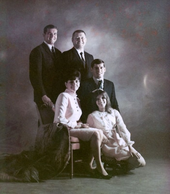 Before Lance Sijan (left) departed for Vietnam in 1967, his mother had the family pose for a professional portrait. It was the last photograph of the entire family together.