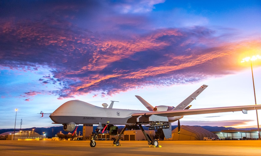 The sun rises over an MQ-9 Reaper remotely piloted aircraft at Holloman Air Force Base, N.M., Dec. 16, 2016. The 49th Aircraft Maintenance Squadron supports the 6th Reconnaissance Squadron as well as the 9th and 29th Attack Squadrons, enabling the graduation of pilots and sensor operators in support of the Air Force's largest formal training unit. Additionally, Airmen with the 49th AMS continuously deploy in support of intelligence, surveillance and reconnaissance requirements. (U.S. Air Force photo by J.M. Eddins Jr.)