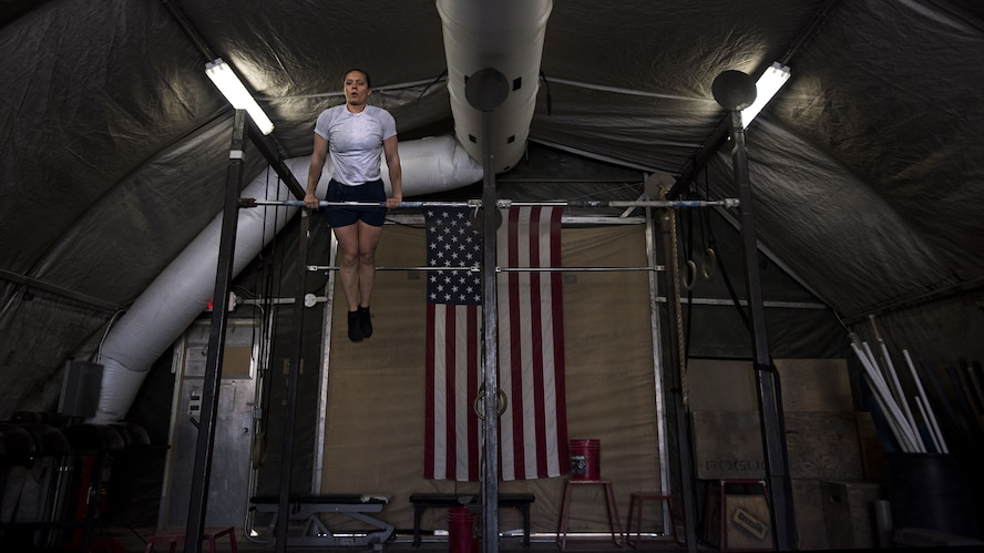 First Lt. Michelle Petry, 455th Expeditionary Civil Engineer Squadron operations flight commander, performs pull ups at Bagram Airfield, Afghanistan, March 23, 2017. Petry was recently selected for explosives ordnance disposal school which she will attend once she redeploys. (U.S. Air Force photo by Staff Sgt. Katherine Spessa)