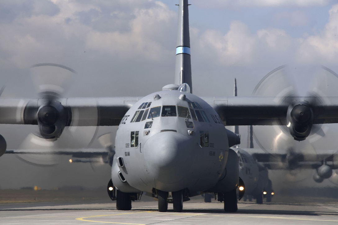 U.S. and Polish C-130 Hercules aircraft prepare to fly a 4-ship formation at Powidz Air Base, Poland, March 24, 2017.  Airmen from both countries participated in bilateral training during Aviation Detachment 17-2 in support of Operation Atlantic Resolve.  These bilateral trainings focused on maintaining joint readiness while building interoperability.  (Air National Guard photo by Staff Sgt. Alonzo Chapman).