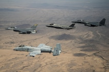Col. Kurt Gallegos, the 944th Fighter Wing commander, leads a four-ship formation with the A-10 Thunderbolt II, F-35 Joint Strike Fighter and F-15 Strike Eagle, during his fini-flight near Luke Air Force Base, Ariz., June 2, 2017. Gallegos, a career F-16 Fighting Falcon pilot with more than 4,100 hours, was the first F-16 pilot to drop bombs in Afghanistan after the September 11, 2001 attacks. His fini-flight marks the end of a 32-year Air Force career. (U.S. Air Force photo by Tech. Sgt. Larry E. Reid Jr.)