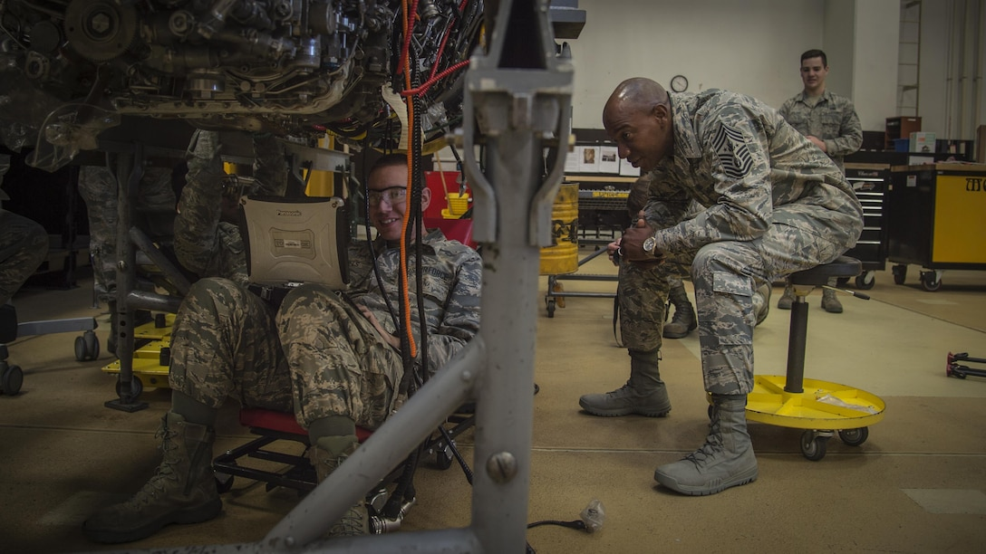 Chief Master Sgt. of the Air Force Kaleth O. Wright speaks with Airman 1st Class Jeremy Daniels, 35th Maintenance Squadron aerospace propulsion journeyman, during his Pacific Air Forces' immersion tour at Misawa Air Base, Japan, June 9, 2017. Wright toured various work centers, focusing his visit on innovative Airmen who contribute to the overall growth of the Air Force. He also sat with Airmen and NCO's to learn more about their concerns about the Air Force. (U.S. Air Force photo by Senior Airman Deana Heitzman)