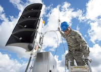 U.S. Air Force Airmen from the 210th Engineering Installation Squadron add an antenna to a newly installed Giant Voice stack located on the roof of the Small Air Terminal at the 133rd Airlift Wing in St. Paul, Minn., June 19, 2017. Once complete, the system will provide improved emergency notification capabilities to flight line and maintenance personnel while aircraft engines are running. Strobes will also light up on top of the stack as an added visual durning alerts.    (U.S. Air National Guard photo by Tech. Sgt. Austen R. Adriaens)