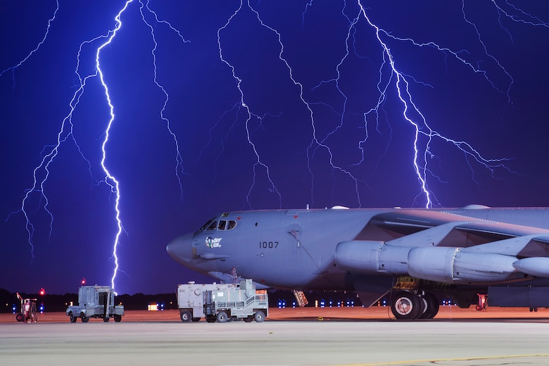 Lightning strikes behind a B-52H Stratofortress at Minot Air Force Base, N.D., Aug. 8, 2017. In a conventional conflict, the B-52 can accomplish strategic attacks, close-air support, air interdiction, offensive counter-air and maritime operations. (U.S. Air Force photo by Senior Airman J.T. Armstrong)
