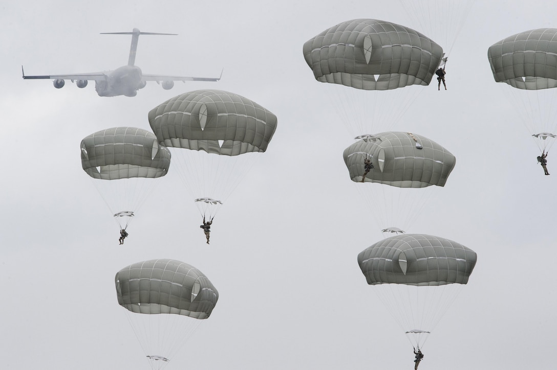 Paratroopers assigned to the 4th Infantry Brigade Combat Team (Airborne), 25th Infantry Division, U.S. Army Alaska, descend after jumping from a C-17 Globemaster III out of Joint Base Charleston, while conducting airborne training over Malemute drop zone, Joint Base Elmendorf-Richardson, Alaska, Aug. 24, 2017. The Soldiers of 4/25 recently completed a series of jumps to ensure that they maintain their airborne qualification during the brigade's upcoming deployment to Afghanistan. (U.S. Air Force photo by Alejandro Peña)