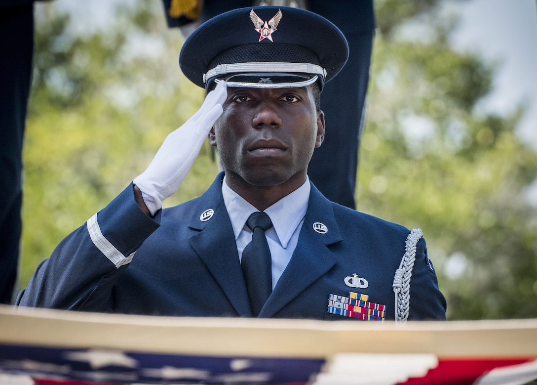 Staff Sgt. Andrew Johnson, 96th Operations Support Squadron honor guardsman, salutes during the flag-folding portion of the unit's graduation ceremony at Eglin Air Force Base, Fla., Sept. 8, 2017. Approximately 14 new Airmen graduated from the 120-plus-hour course. The graduation performance includes flag detail, rifle volley, pallbearers and bugler for friends, family and unit commanders. (U.S. Air Force photo by Samuel King Jr.)