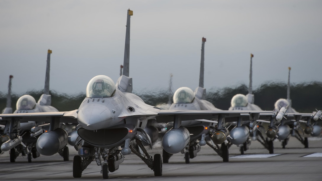 During Beverly Sunrise 17-07, an annual wing-wide readiness exercise planned months in advance, 18 F-16 Fighting Falcons from the 13th and 14th Fighter Squadron, line the runway during an elephant walk at Misawa Air Base, Japan, Sept. 16, 2017. BS 17-07 is a simulated deployment to test the readiness of the 35th Fighter Wing. The exercise assesses the 35th FW's ability to meet deployment and wartime taskings to better prepare for real-world scenarios throughout the Indo-Asia-Pacific region. (U.S. Air Force photo by Staff Sgt. Deana Heitzman)