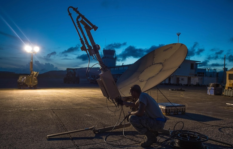 Staff Sgt. Trevor Black, 821st Contingency Response Support Squadron small package initial communications element technician, checks wires on a satellite communication antenna at Roosevelt Roads, Puerto Rico, Sept. 25, 2017. A 70 member contingency response element from the 821st CRG stationed at Travis Air Force Base, Calif., deployed to Puerto Rico in support of Hurricane Maria relief efforts. (U.S. Air Force photo by Staff Sgt. Robert Hicks)
