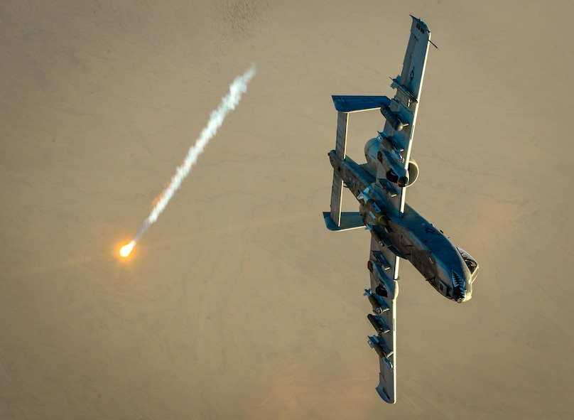 An A-10 Thunderbolt II shoots a flare off after receiving fuel from a 340th Expeditionary Air Refueling Squadron KC-135 Stratotanker in support of Operation Inherent Resolve Oct. 6, 2017. The aircraft can loiter near battle areas for extended periods of time and operate in low ceiling and visibility conditions. The wide combat radius, and short takeoff and landing capabilities, permit operations in and out of locations near front lines. (U.S. Air Force photo by Staff Sgt. Michael Battles)