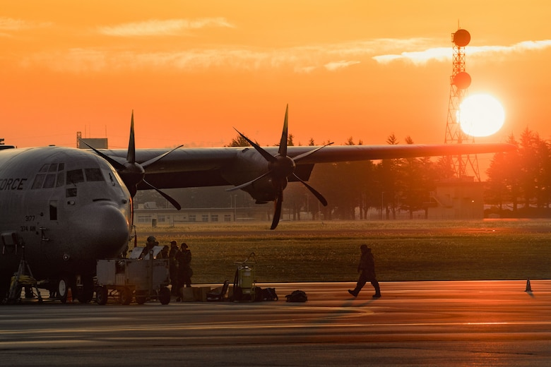 A crew chief assigned to the 374th Aircraft Maintenance Squadron walks on the flightline during Exercise Beverly Morning 17-06 at Yokota Air Base, Japan, Oct. 26, 2017. Yokota AB received the C-130J Super Hercules from Dyess Air Force Base, Texas. (U.S. Air Force photo by Yasuo Osakabe)