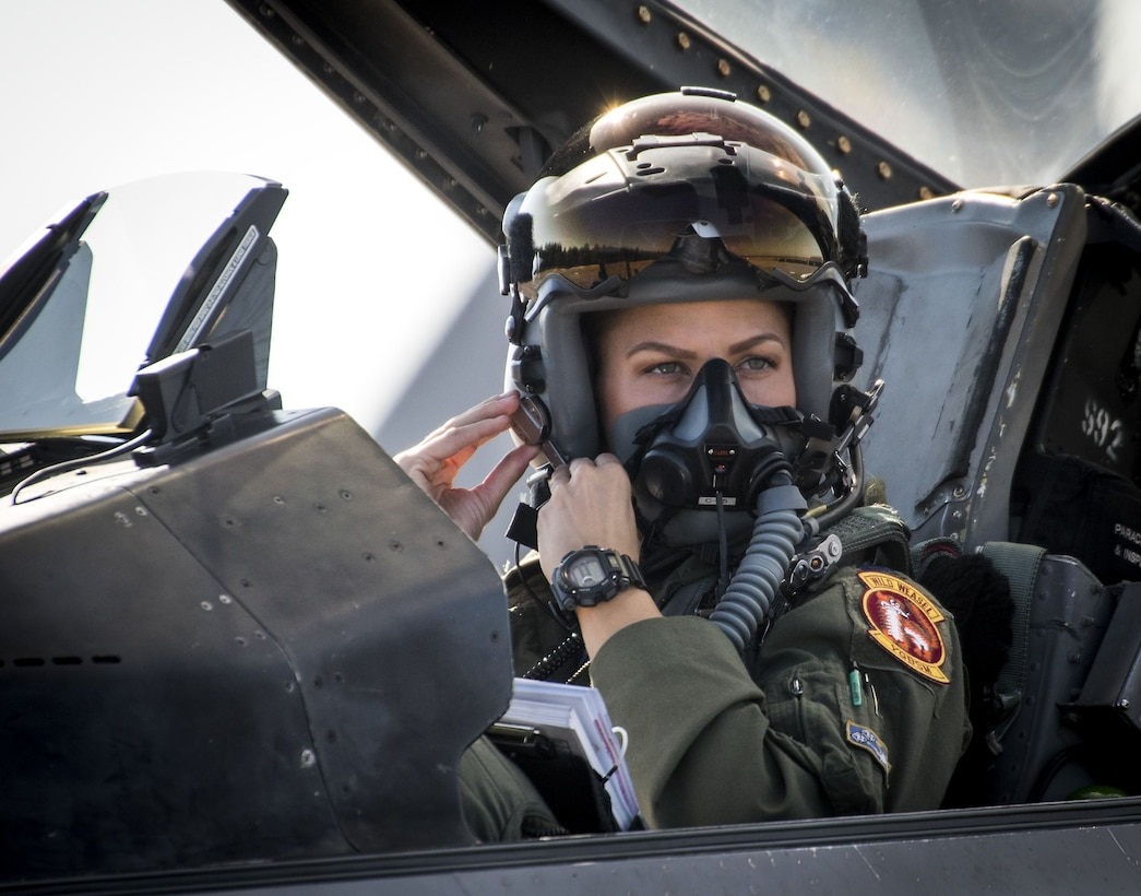Capt. Zoe Kotnik, 55th Fighter Squadron pilot from Shaw Air Force Base, S.C., clips on her mask in her F-16 Fighting Falcon prior to a Combat Hammer sortie Nov. 2, 2017, at Eglin AFB, Fla.  A-10 Thunderbolt IIs, F-16s, F-22 Raptors and MQ-9 Reapers visited the base to participate in the 53rd Wing exercise. The 86th Fighter Weapons Squadron's Combat Hammer is a weapons system evaluation program for air-to-ground munitions. (U.S. Air Force photo by Samuel King Jr.)